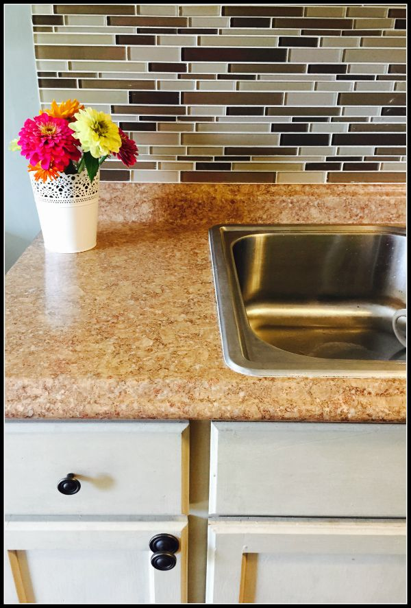 backsplash with oak cabinents and Anne Sloane Paint