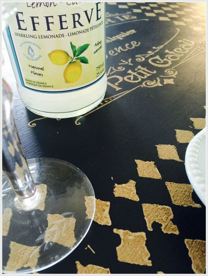 dining room table with stencil and cups