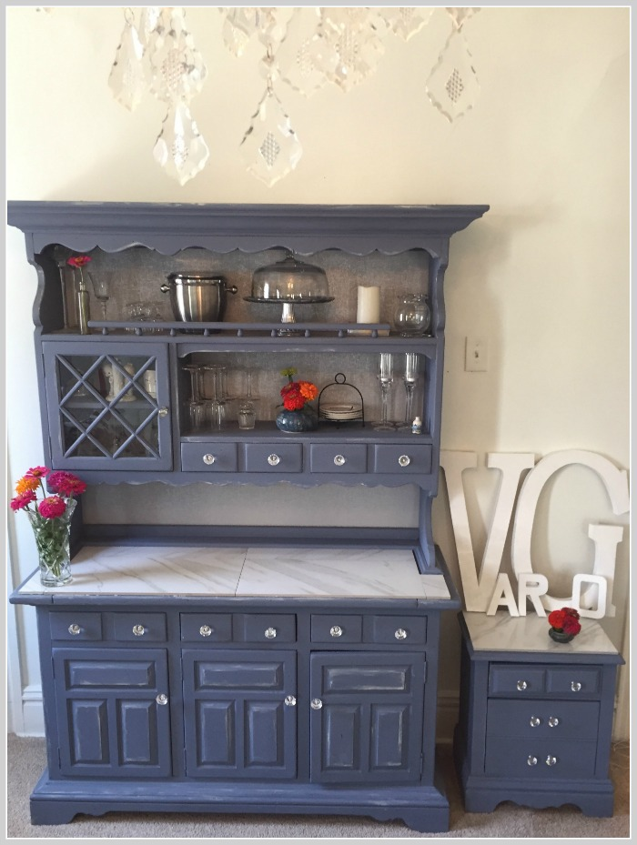dining room hutch with chandelier