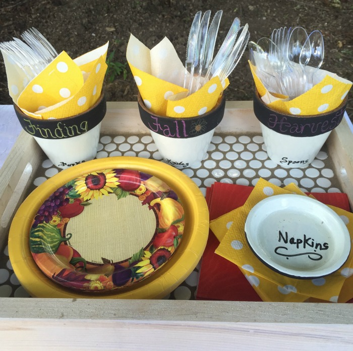 painted clay pots as silverware holders