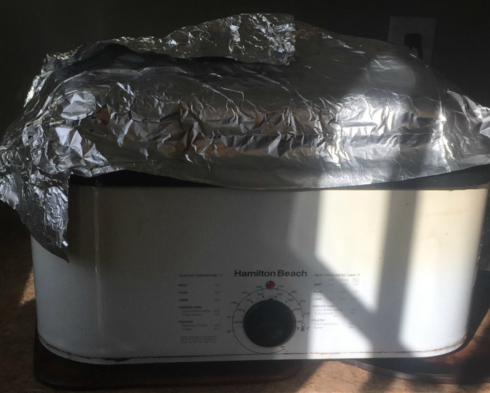 cooking a turkey in a roaster with foil