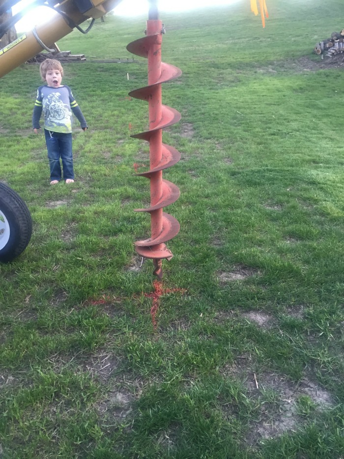 auger with marks for where to dig
